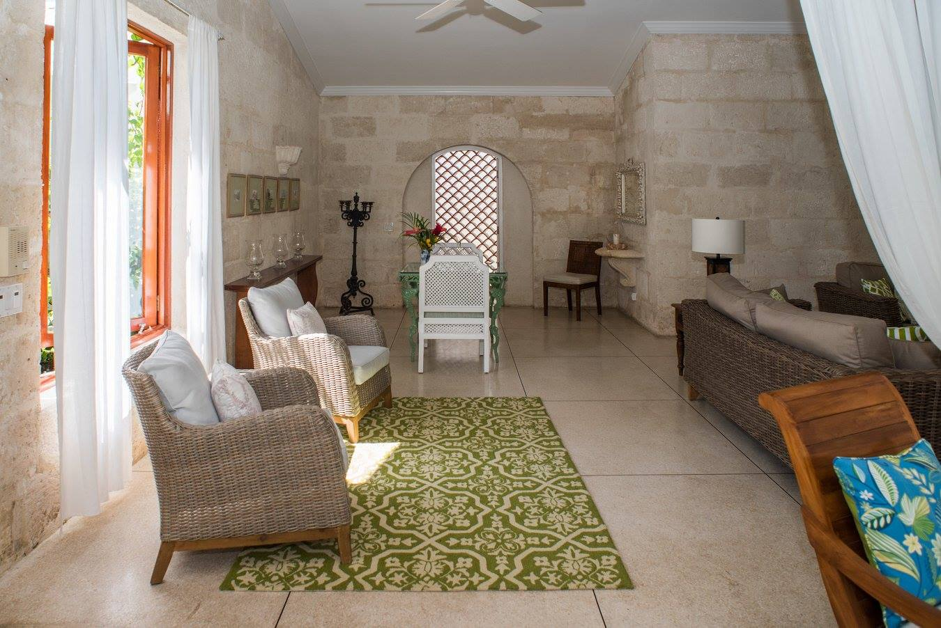stone walls with table and chairs
