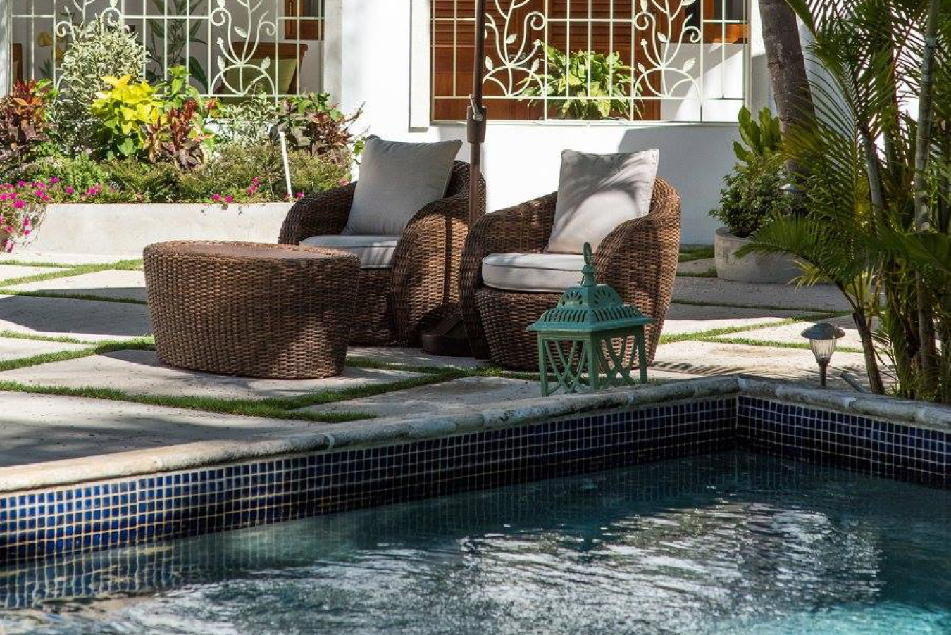 shot of swimming pool with chairs and brolley
