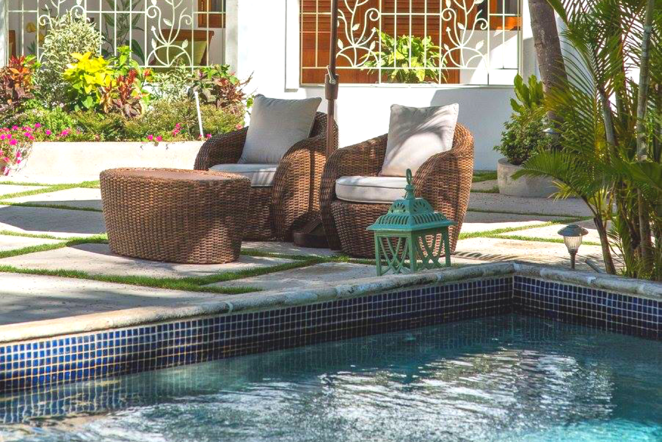 swimming pool with chair loungers in background