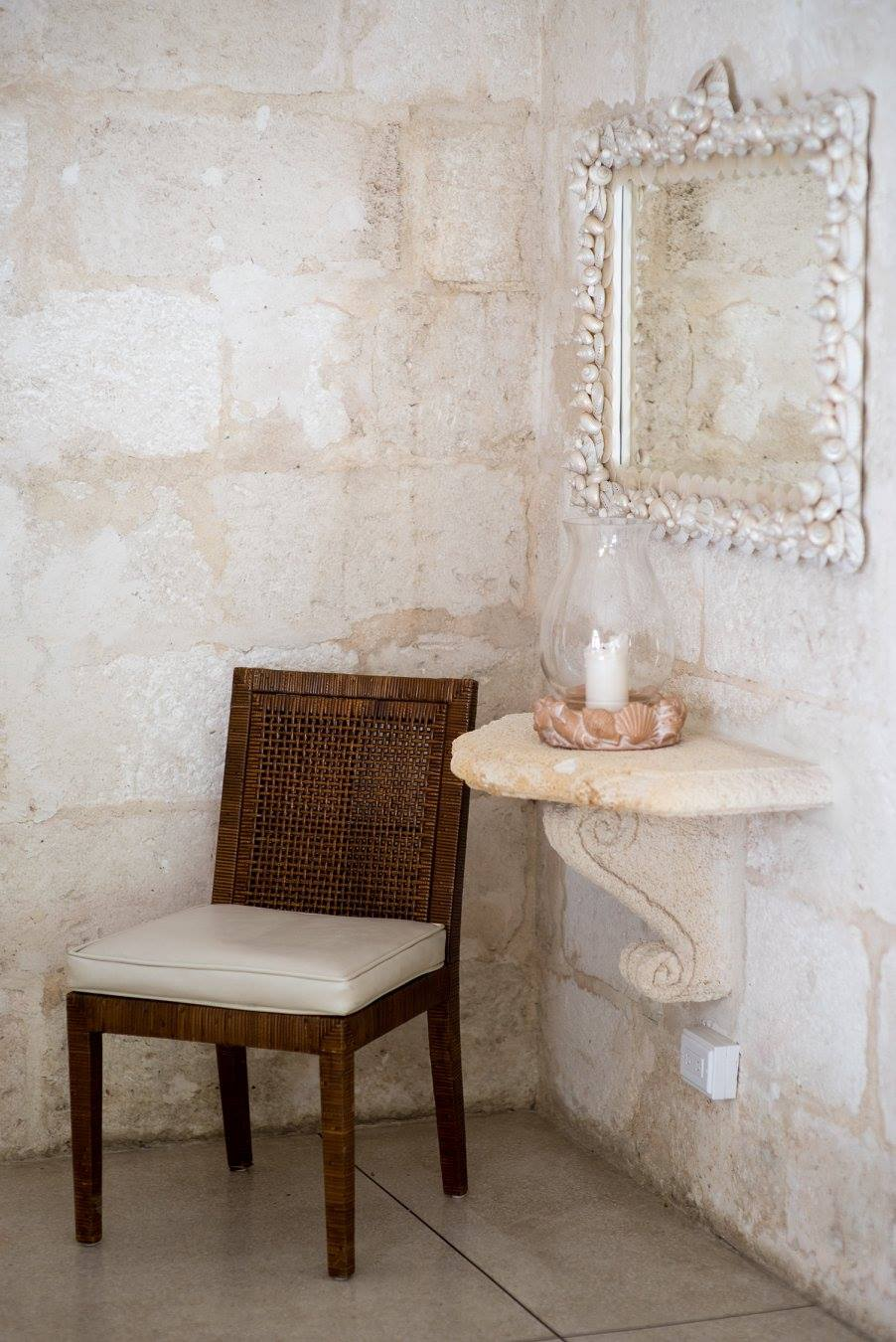 stone wall with a mirror in a villa in Barbados