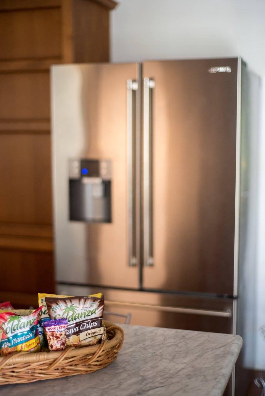 fridge door inside a villa to rent in Barbados