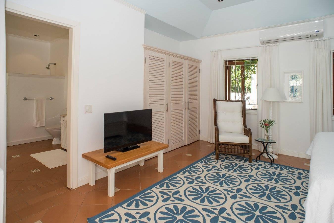 TV inside a bedroom of a villa in Barbados