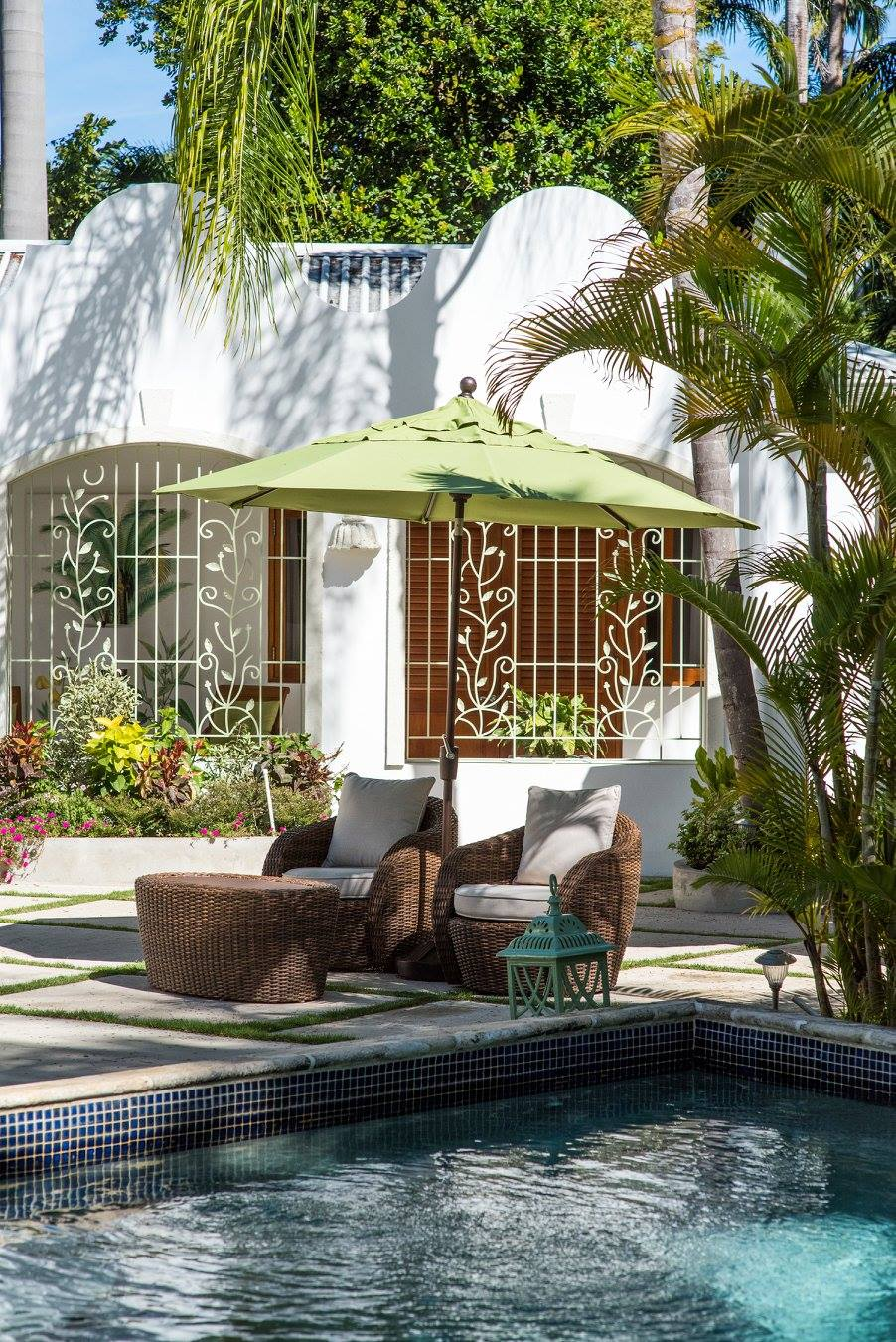sun loungers by the pool of a villa to rent in Barbados